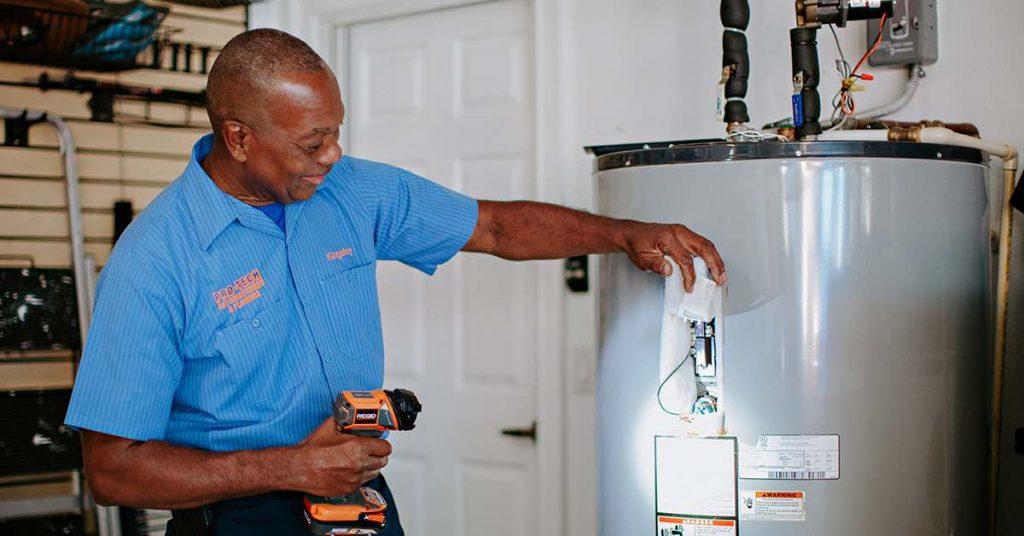 Plumber working on water heater